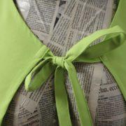 Grembiule clips verde mela particolare